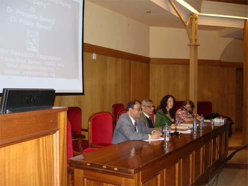 Dr. Banerjis at a conference in Spain